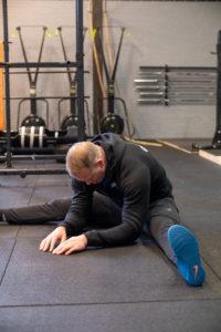 Squat mobility routine V-sit stretch